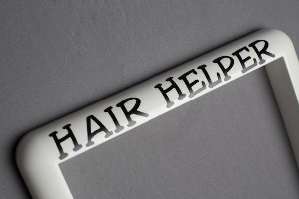 Black Lettering on the white Hair Helper Frame