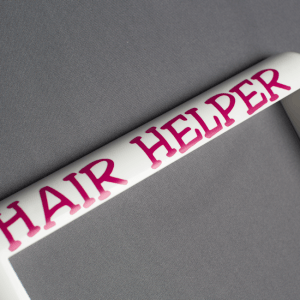 Pink Lettering on the Hair Helper Frame