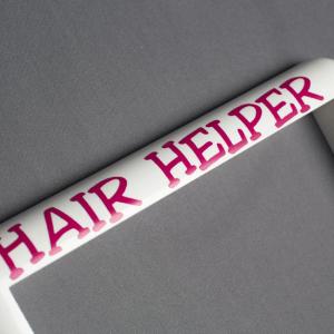 Pink Lettering on the Hair Helper Frame