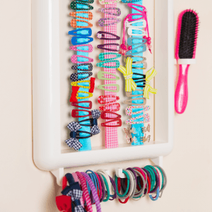 The white Hair Helper storing hairclips, grips, brush, bands and bobbles