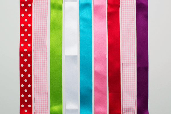 The ribbons available for the Hair Helper are red polka dot, pink gingham, green, white, blue, dark pink, red, light pink and purple